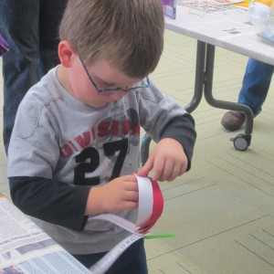 Portland Public Library, Maine; making a moon lantern with paper strips and a straw